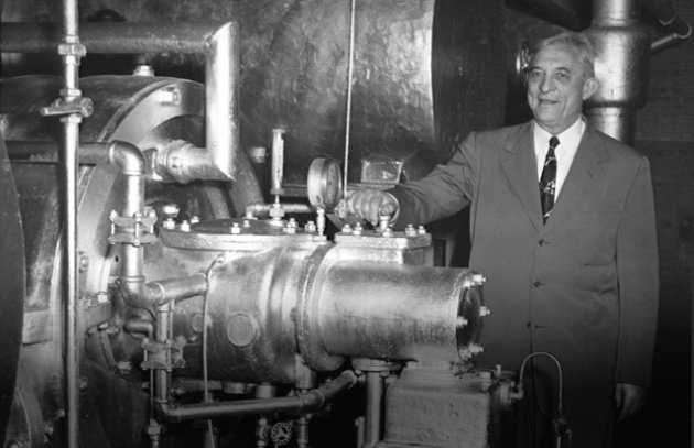 Willis Carrier next to one of his air conditioning machines. Williscarrier.com